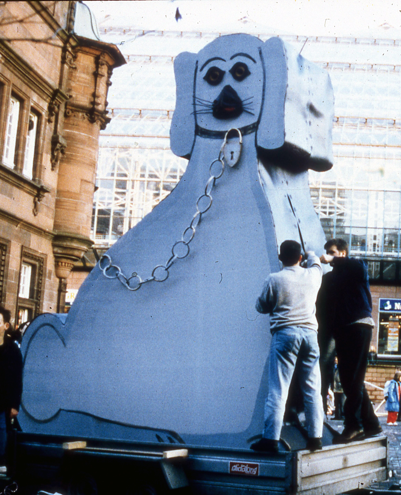 George Wyllie's 15 foot Wally Dug sculpture on a trailer in St Enoch Square Glasgow